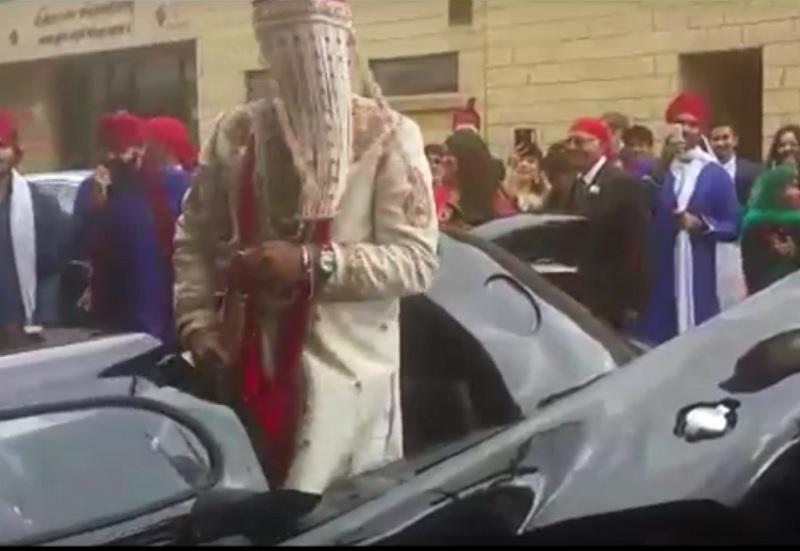 groom entering in a batmobile
