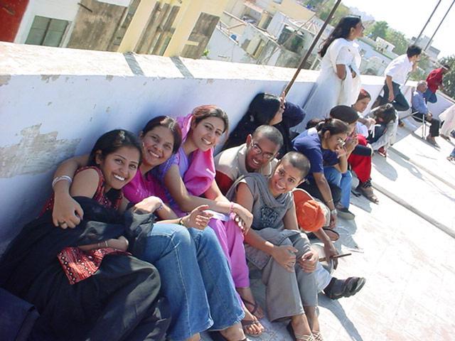 ladies from neighbourhood gossip during uttarayan on terrace