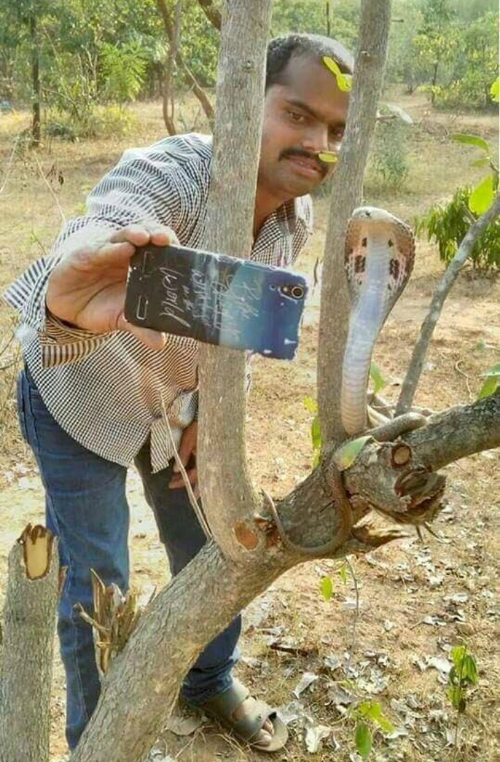 taking selfie with a snake