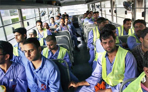 workers brought back to sonapur by bus