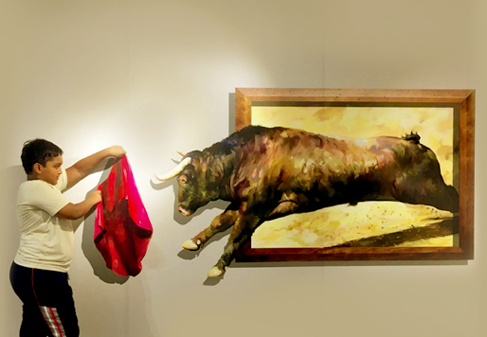 bull coming out of photo frame at 3d art museum in chennai