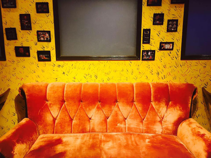 friends cafe in kolkata orange sofa