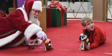 Santa Crawls On The Floor To Help Autistic Boy
