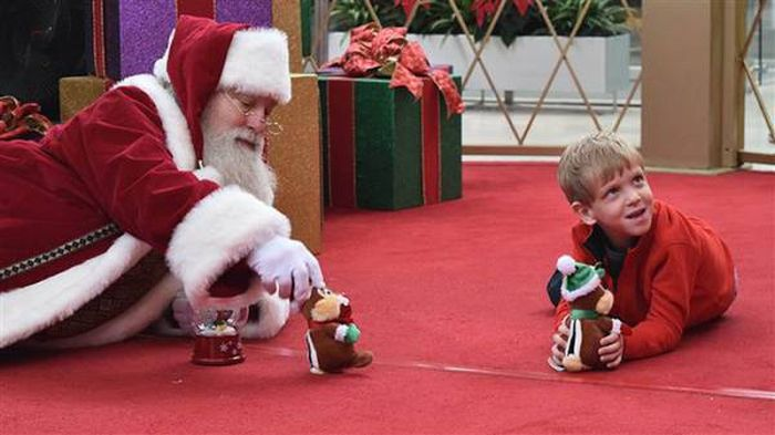 Santa Crawls On The Floor To Help Autistic Boy